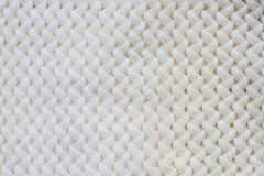 Sweater or scarf Pattern Of White Knitted Fabric Texture Background.  Stock Photography