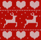 Sweater seamless background with deers and hearts. Royalty Free Stock Image