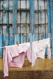 Sweater and t-shirt hanging on a clothes line Royalty Free Stock Photos