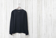 Sweater on a white wood wall Stock Photos