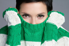 Sweater Woman. Playful winter sweater woman dressing Royalty Free Stock Photography