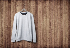 Sweater on a wood wall Stock Photo