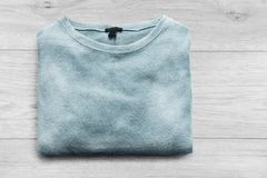 Sweater on wooden background Royalty Free Stock Photos