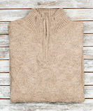 Sweater on wooden background Royalty Free Stock Images