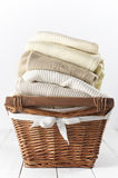 Sweaters in basket Stock Images