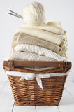Sweaters in basket Royalty Free Stock Images