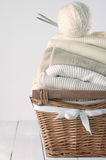 Sweaters in basket Stock Photo