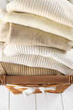 Sweaters in basket Royalty Free Stock Photo