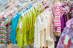 Sweaters and blouses on stands in kids mall Stock Photography