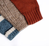 Sweaters isolated. Colorful fashion sweaters isolated on white royalty free stock photo