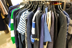 Sweaters and t-shirts for sale Stock Images