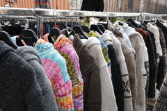 Sweaters and vintage clothes for sale at the  flea market. Sweaters and vintage clothes for sale in open-air flea market Royalty Free Stock Photography