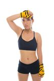 Sweating. Vertical portrait of a sweating kickboxer isolated against white background Stock Images