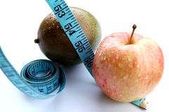 Sweating Apple And Mango (Dieting) Stock Photos