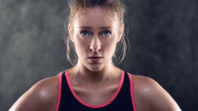Sweating Athletic Blond Woman Wearing Tank Top Stock Images