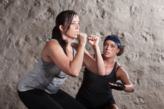 Sweating During Boot Camp Style Workout. Caucasian athlete sweating with trainer in boot camp training workout Stock Image