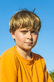 Sweating boy after sports under blue sky Stock Image