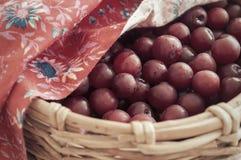 Sweating cherries. In wicker basket Royalty Free Stock Photo