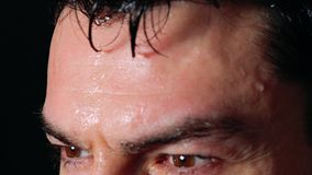 Sweating man forehead -Close up. Sweating man forehead -Close up stock footage