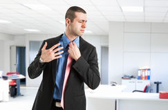 Sweating man. Man sweating in his office Stock Images