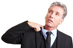 Sweating manager. Pulling his shirt with his finger Royalty Free Stock Photography