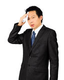 Sweating middle age Asian business man on white. Isolated sweating middle age Asian business man on white Royalty Free Stock Photography