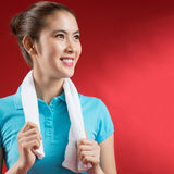 Sweating sportswoman. Isolated image of a sweating sportswoman over a red background Royalty Free Stock Image