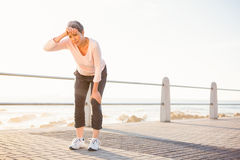 Sweating sporty woman resting at promenade Stock Image
