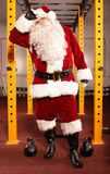 Sweating, tired Santa Claus. Having break in training in gym royalty free stock photography
