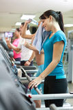 Sweating woman in gym Stock Photo