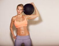 Sweaty Athlete with Ball on Her Shoulder Royalty Free Stock Image
