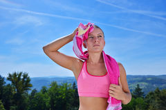 Sweaty fitness woman tired after training. Stock Image