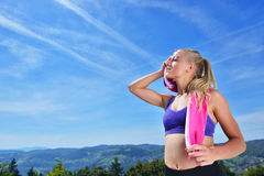 Sweaty fitness woman tired after training. Royalty Free Stock Photography