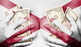 Sweaty girl covered her breast with money, flag of Alabama Stock Photos
