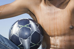 Sweaty Man's Torso With Soccer Ball Stock Photography