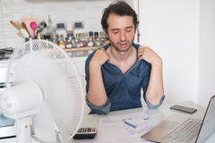 Free Sweaty Man Trying To Refresh From Heat With Fan Stock Image - 95918091