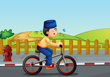 A sweaty muslim riding on a bike Royalty Free Stock Images