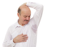 Sweaty spot on the shirt because of the heat, worries and diffidence. Stock Photos