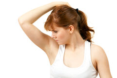 Sweaty woman checking scent Royalty Free Stock Photography