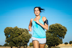 Sweaty woman running cross trail. Woman running cross trail in countryside on summer. Sweaty fit girl exercising royalty free stock photos