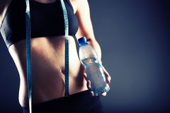 Sweaty woman after training holding water bottle Royalty Free Stock Photography