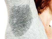 Sweaty woman wet stain under arm. Sweaty woman with wet stain under arm. Bad sweating, hyperhidrosis sweat, health social problem royalty free stock images