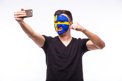 Swede football fan support for game Sweden national team on white background Stock Photo