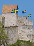 Sweden!. Swedish flags on the wall surrounding Visby. Gotland, Sweden Stock Images