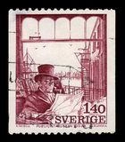 Man in top hat, reading a newspaper in publicists club. SWEDEN - CIRCA 1974: stamp printed in Sweden, shows man in a suit and top hat, reading a newspaper in Royalty Free Stock Image