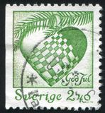 Plaited heart. SWEDEN - CIRCA 1993: stamp printed by Sweden, shows Plaited heart, circa 1993 royalty free stock photo