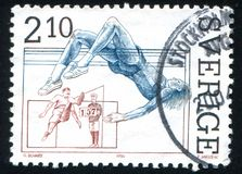 Standing high jumper and Patrik Sjoberg. SWEDEN - CIRCA 1986: stamp printed by Sweden, shows Standing high jumper and Patrik Sjoberg, high jump, circa 1986 Stock Photography