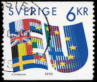SWEDEN - CIRCA 1995: A stamp printed in SWEDEN shows stylized flags of European Union (EU) countries circa 1995 Royalty Free Stock Image