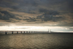 Between Sweden and Denmark. Clouds over the Oresund bridge. Between Sweden and Denmark. View of the bridge linking Sweden (Malmo) with Denmark (Kopenhavn Royalty Free Stock Images
