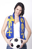 Sweden fan. Girl wearing a scarf of Sweden and holding football Stock Photo